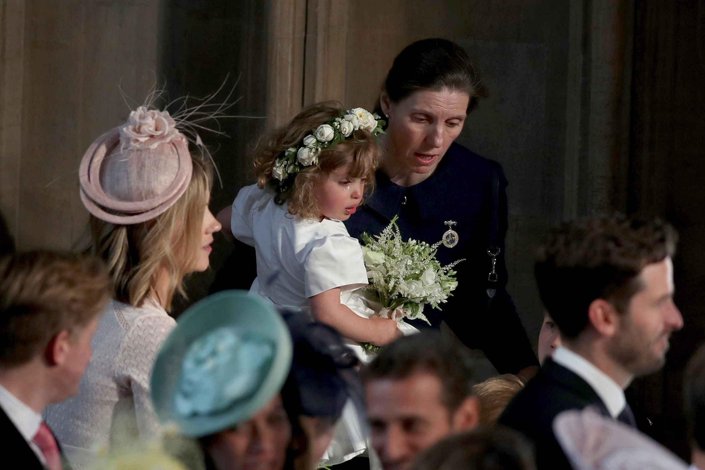 The royal wedding featured plenty of happy tears as guests celebrated the beautiful ceremony, but there was at least one member of the wedding party who was weeping for another reason. One of the young bridesmaids , possibly the youngest of the group, two-year-old Zalie Warren, found the spectacle a little overwhelming and had to be cared for by the royal nanny, Maria Teresa Turrion Borrallo , during the ceremony.