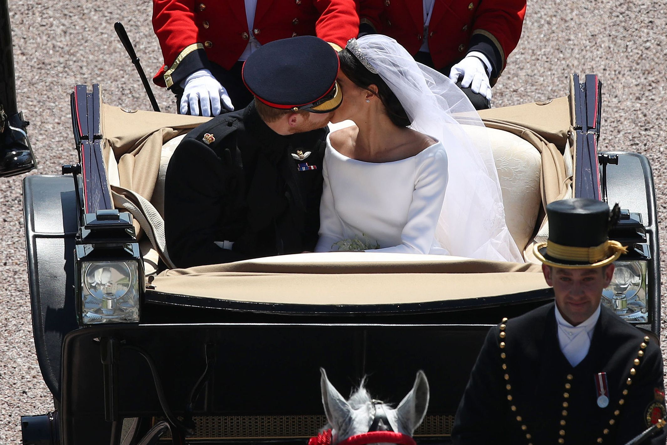 Though the royal family has traditionally been pretty reserved on the PDA front, the happy couple sneaked in a second public smooch during their post-ceremony procession. (Their first public kiss was shared, in traditional fashion, in front of St. George's Chapel immediately following the ceremony.)