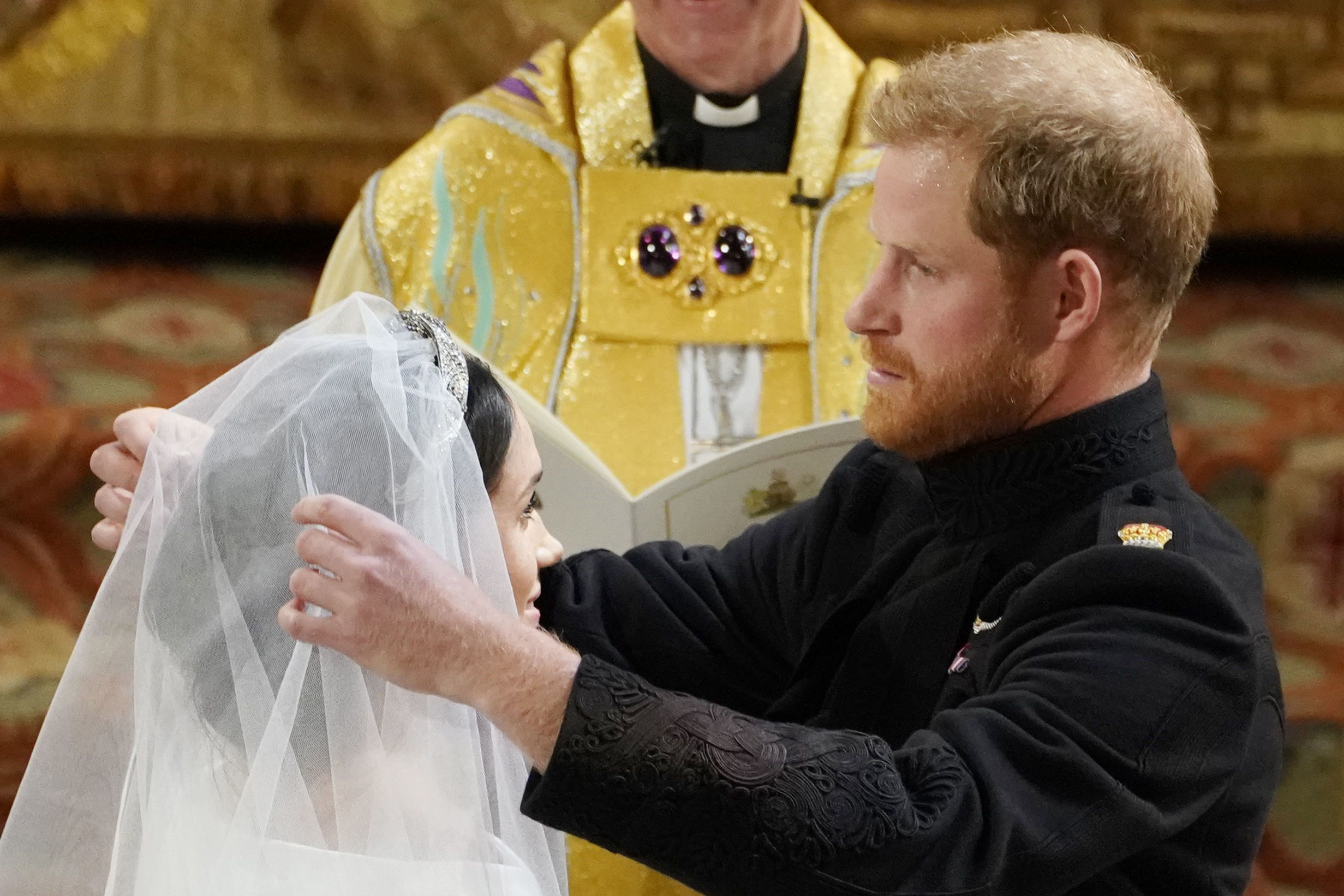 Traditionally the purview of the father of the bride, the newly-minted Duke of Sussex took on the role of removing his bride's veil... and fumbled it just a little . The moment served as an endearing reminder that as carefully choreographed as the royal wedding might have been, in the end it was all about the love between one real couple.