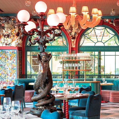 Red, Turquoise, Building, Interior design, Restaurant, Table, Room, Architecture, Tree, Furniture,