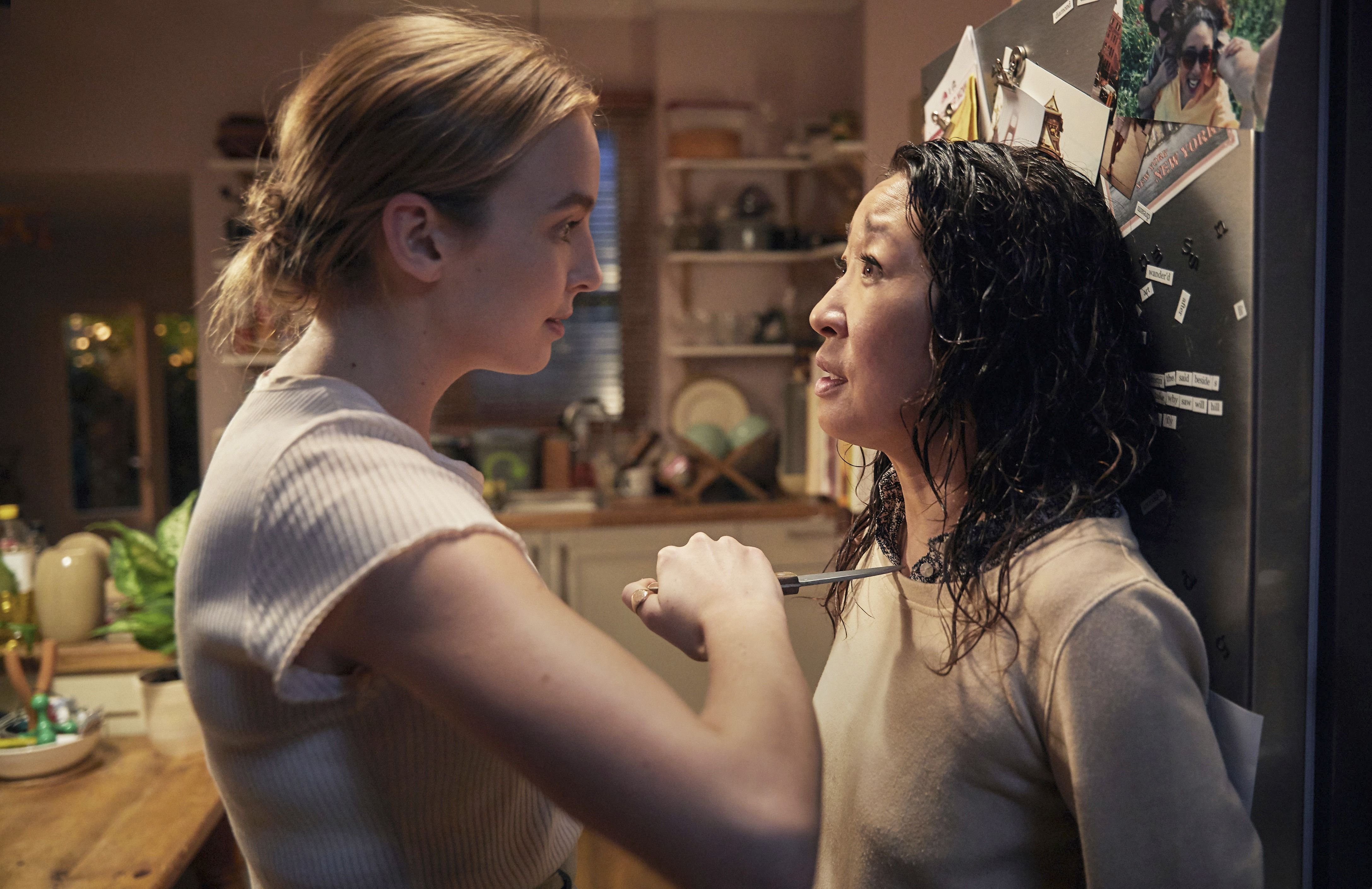 Comer and Sandra Oh in a scene from Killing Eve .