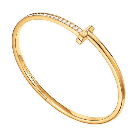 Jewellery, Bangle, Fashion accessory, Body jewelry, Ring, Diamond, Engagement ring, Gold, Bracelet, Oval,
