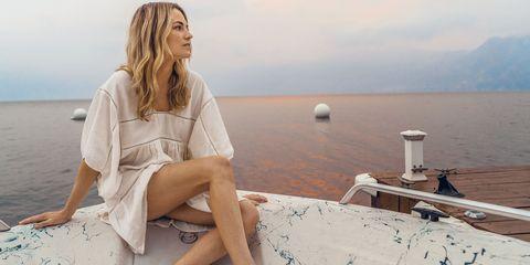 Sitting, Beauty, Leg, Sea, Fashion, Vacation, Summer, Photo shoot, Leisure, Long hair,
