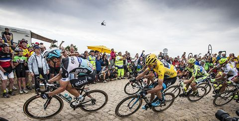Chris Froome rides on one of the seven cobbled sectors on Stage 4 of the 2015 Tour de France