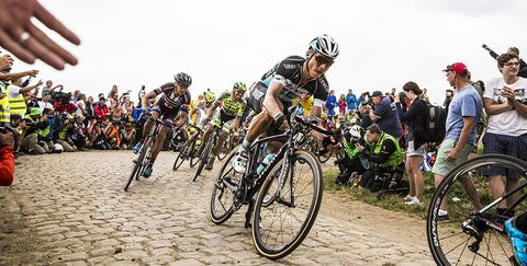 Tony Martin, who took the stage win and the Yellow Jersey, rides over a section of cobbles during Stage 4 of the 2015 Tour de France