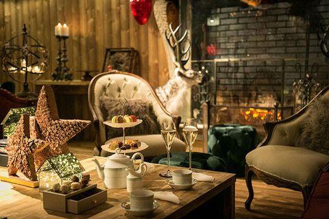 Interior design, Room, Living room, Furniture, Table, Restaurant, Building, Display window, Window, House,
