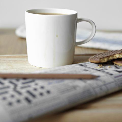 """tea, cookies and crossword on board"""