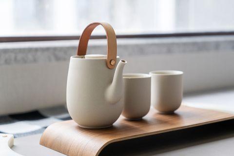 tea cup and tea pot on table