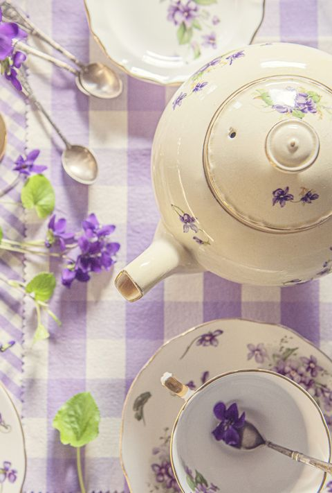 tea cups, plates and violets