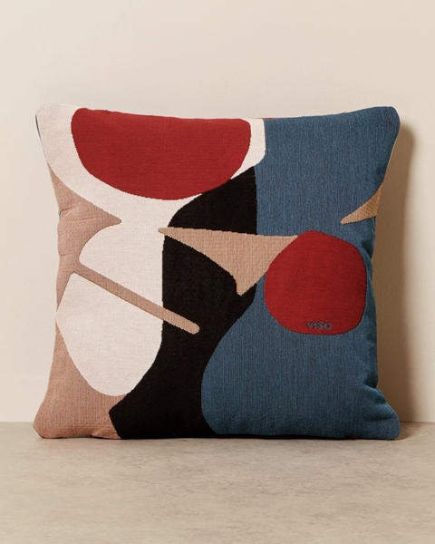 red, teal, black, and pink pillow abstract design