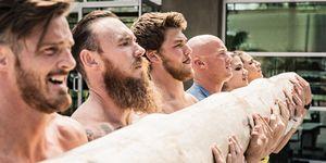 Team of men and women lifting log