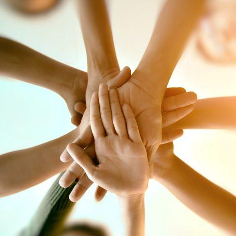 team teamwork join hands