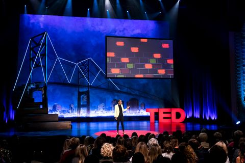"""luvvie performing her ted talk """"getting comfortable with uncomfortable"""" in 2017 on the ted stage"""