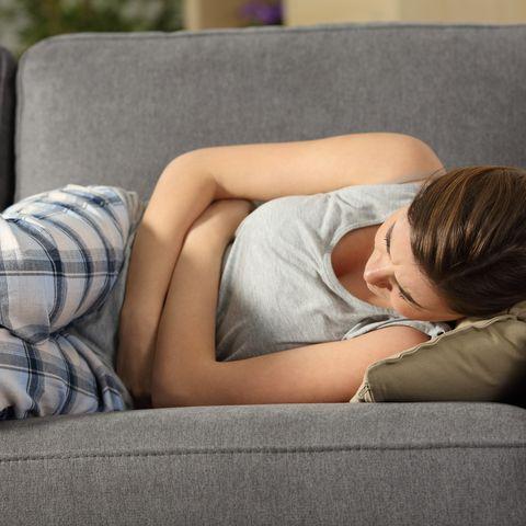teen suffering belly pms symptoms