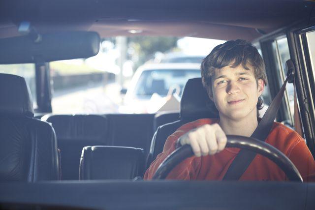 teenage boy driving car