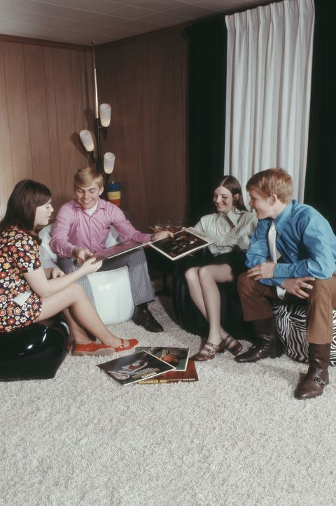 Teenagers sitting on bean bag and record albums