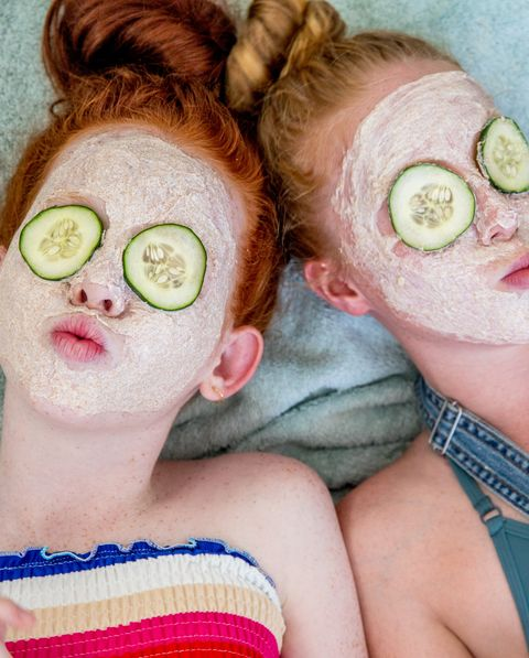 Teenages check out their skin for pimples and apply face masks