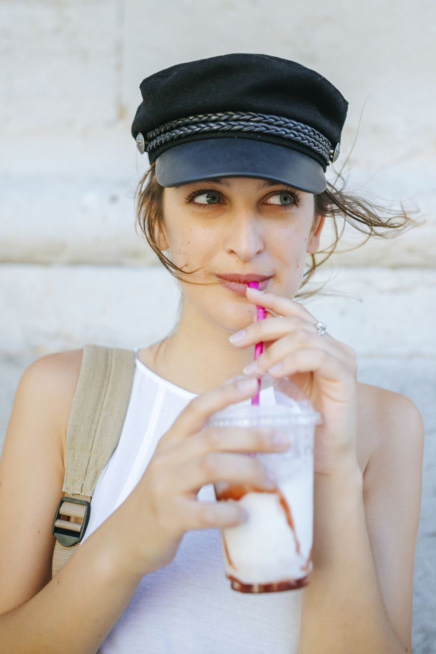 Portrait of young woman drinking a smoothie