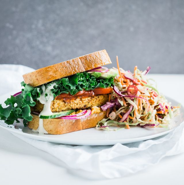 tempeh and kale sandwich with chili coleslaw on table