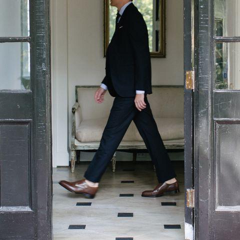 Standing, Leg, Footwear, Street fashion, Outerwear, Suit, Shoe, Ankle, Formal wear, Trousers,