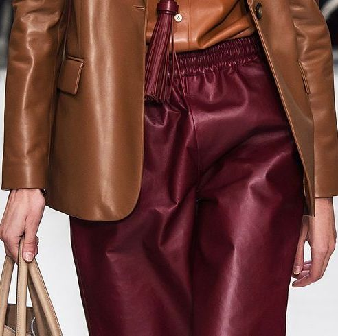 Clothing, Leather, Fashion, Fashion model, Brown, Leather jacket, Outerwear, Haute couture, Jacket, Textile,