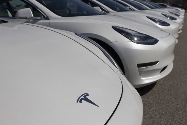 tesla electric vehicles awaiting preparation for sale tesla ev model 3, s and x are a key to a cleaner and greener environment