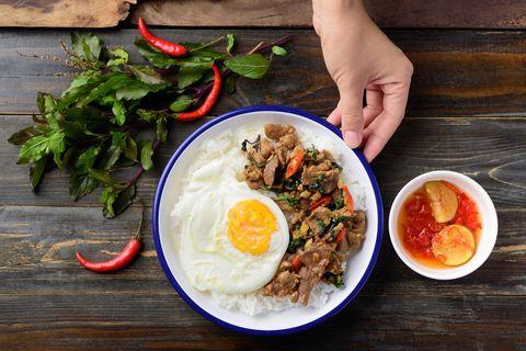 thai food, stir fried pork with basil and fried egg