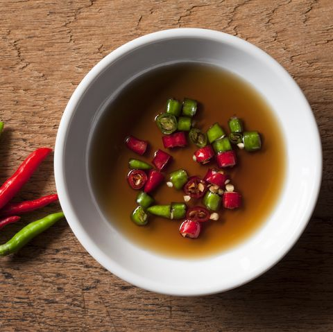 thai red and green chili in bowl of fish sauce