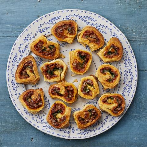 sausage pinwheels on blue and white plate