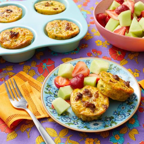 individual sausage casseroles on plate with fruit salad