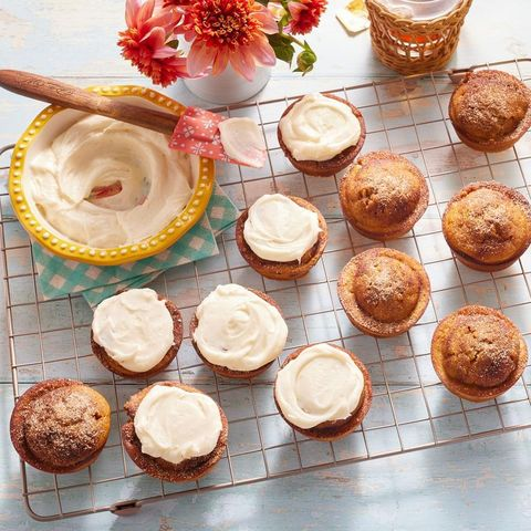 pumpkin spice muffins on wire rack with icing