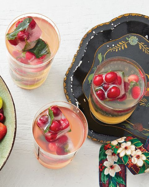 white grape punch with cranberry ice and christmas ribbon
