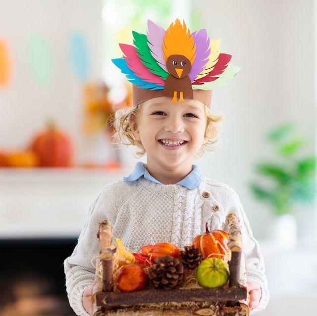 child wearing a turkey headband