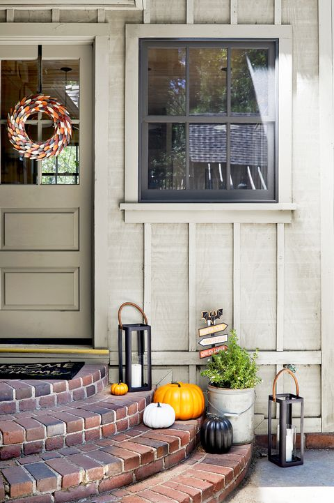 front door and porch decorated for fall