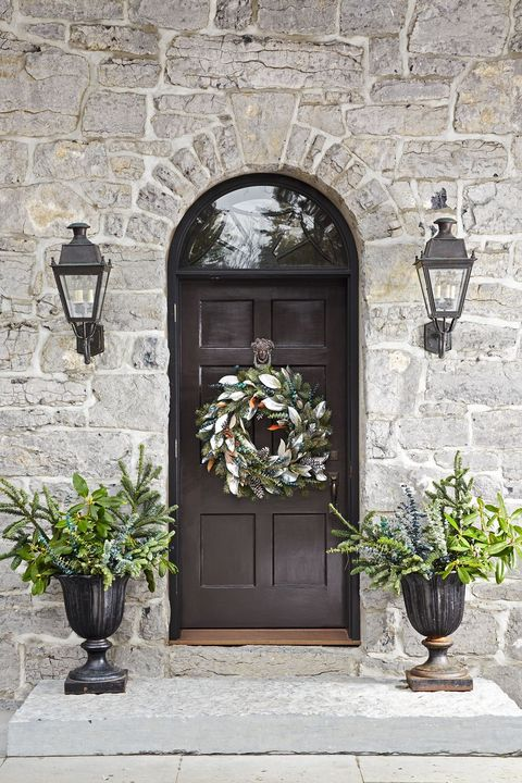 front door with wreath decorated for thanksgiving