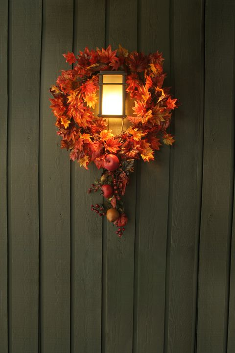 exterior thanksgiving decoration around sconce