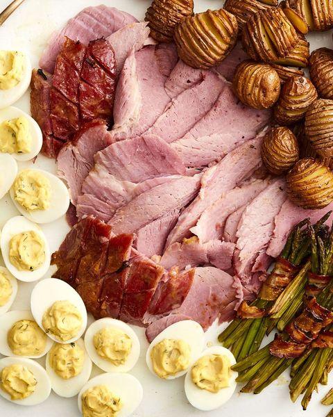 honey mustard glazed ham sliced with hard boiled eggs and potatoes