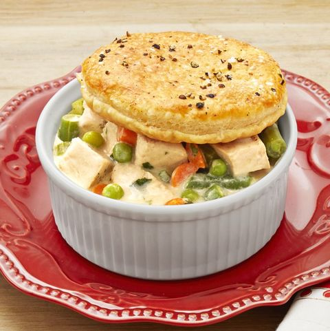 thanksgiving leftover pot pies in white ramekins on red plate