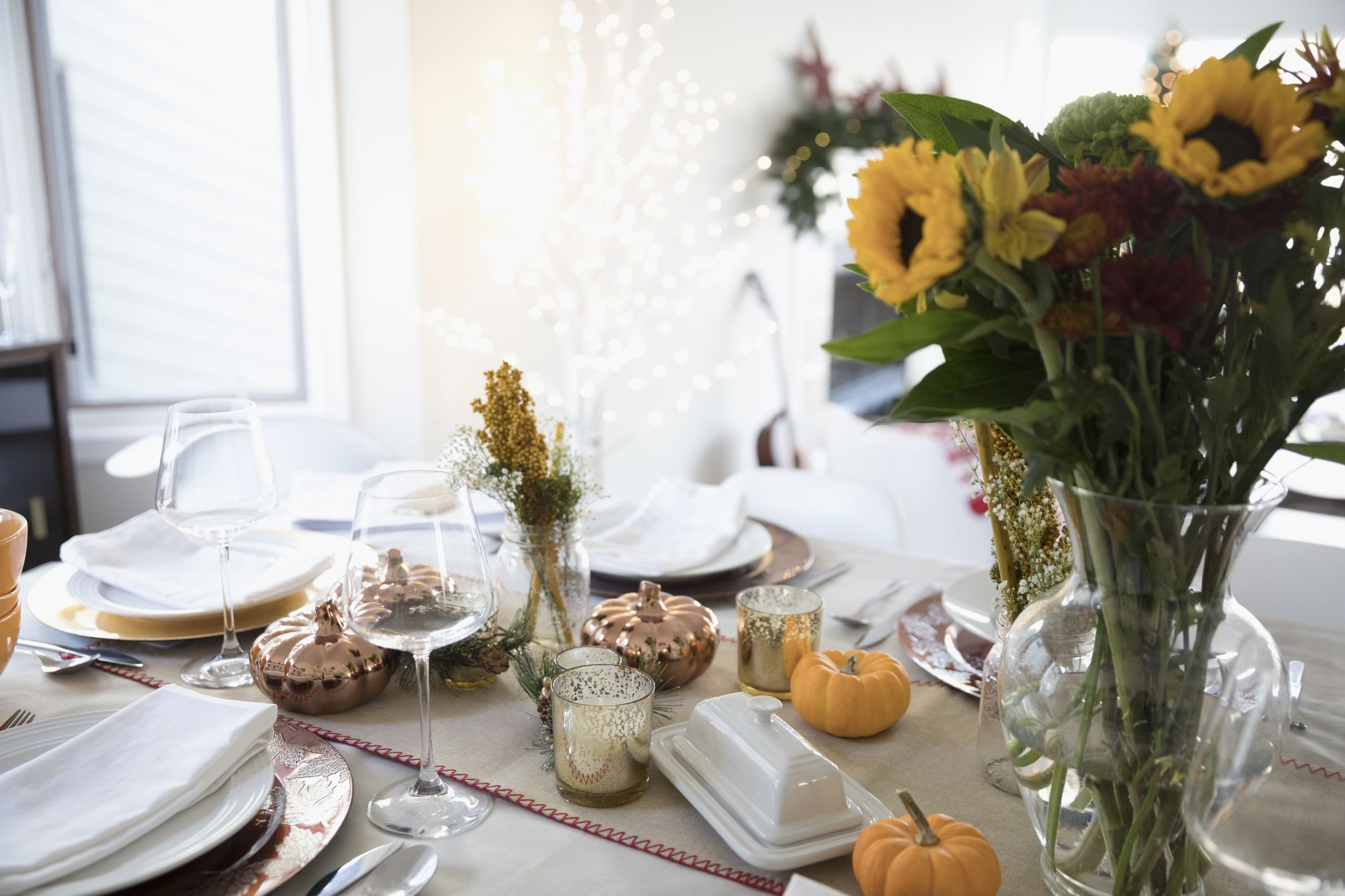 Sunflower Bouquet And Pumpkin Decorations On Thanksgiving Dinner Table