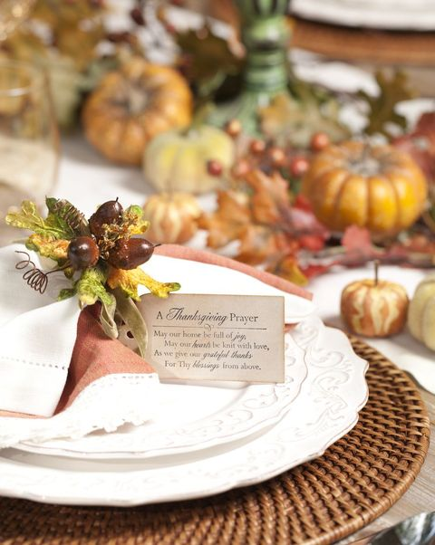 a fancy table setting with a tag that has the thanksgiving prayer printed on it