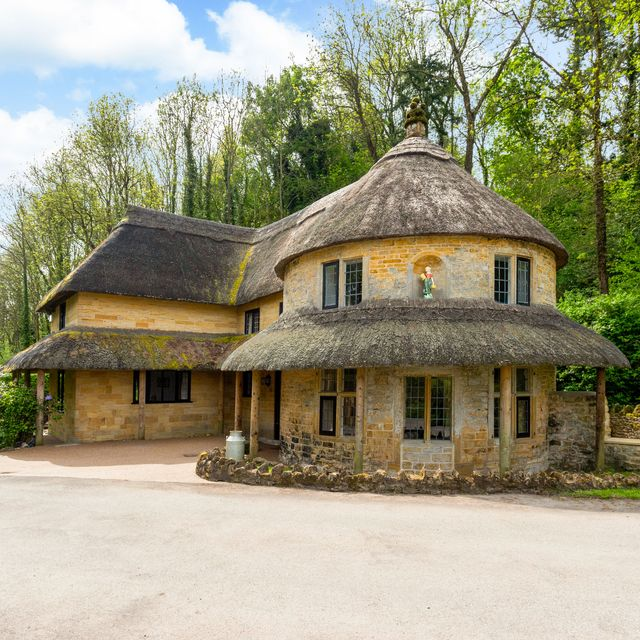 cottage with conical thatched roof for sale in an idyllic dorset village
