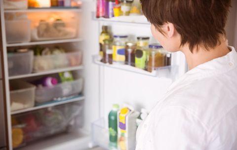 Looking through open fridge