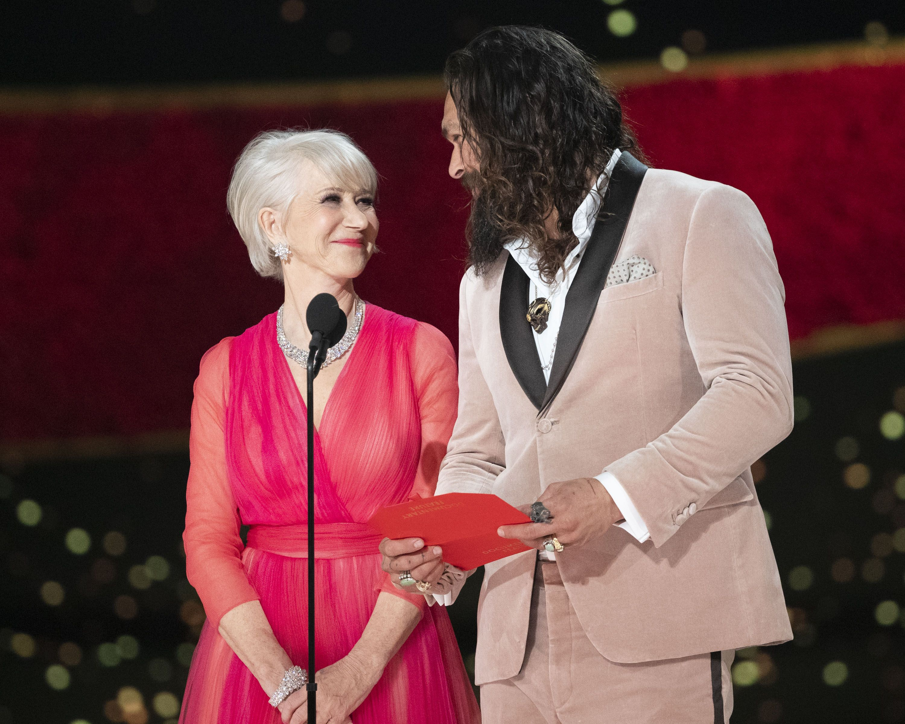 "Helen Mirren Snapped a Sneaky Photo of ""Gorgeous"" Jason Momoa on a Plane"