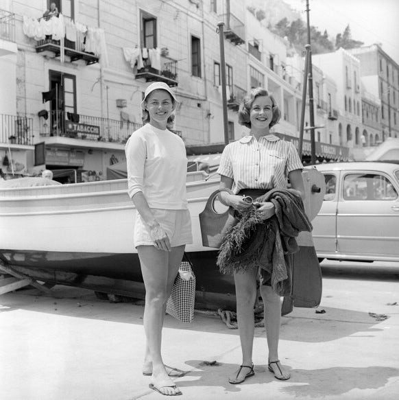 ingrid bregman and pia lindstrom posed pleased on the pier of capri