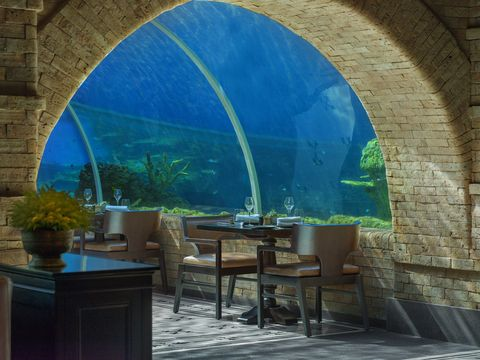 The aquarium dining experience at The Apurva Kempinski Bali