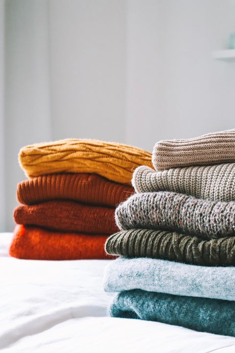 closeup of sweaters on bed