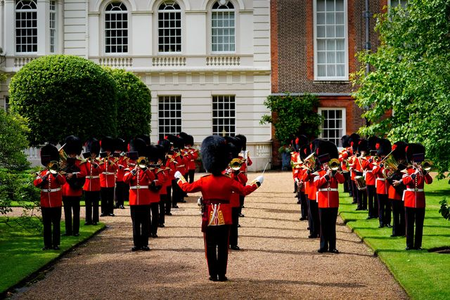 the prince of wales and the duchess of cornwall invite the band of the coldstream to clarence house garden