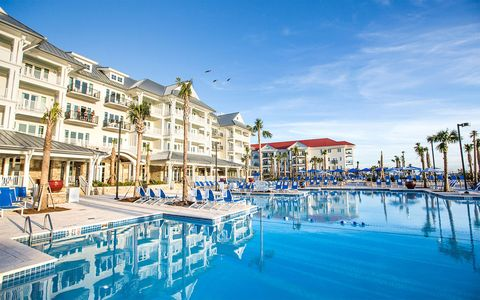 Resort, Swimming pool, Building, Town, Property, Vacation, Sky, Resort town, Real estate, Hotel,
