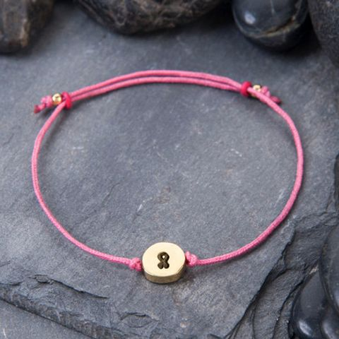Textile, Circle, Natural material, Craft, Button, Bracelet, Body jewelry, Gadget, Leather,