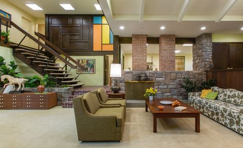 """The Brady Bunch"" House Before and After ""A Very Brady Renovation"" HGTV - Heart of the Home - Living Room, Staircase, Entry"